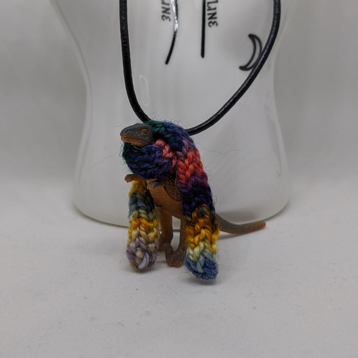 "Dinosaur in Scarf Necklace, 20"" Leather Cord"