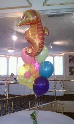Jumbo mylar fish with 5 11inch balloons and blossom