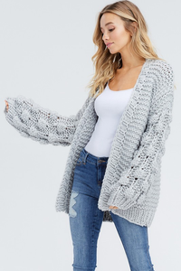 KNITTED CARDIGAN WITH POM DETAILS