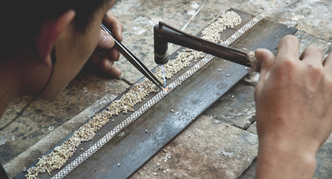 Artisan making silver necklace