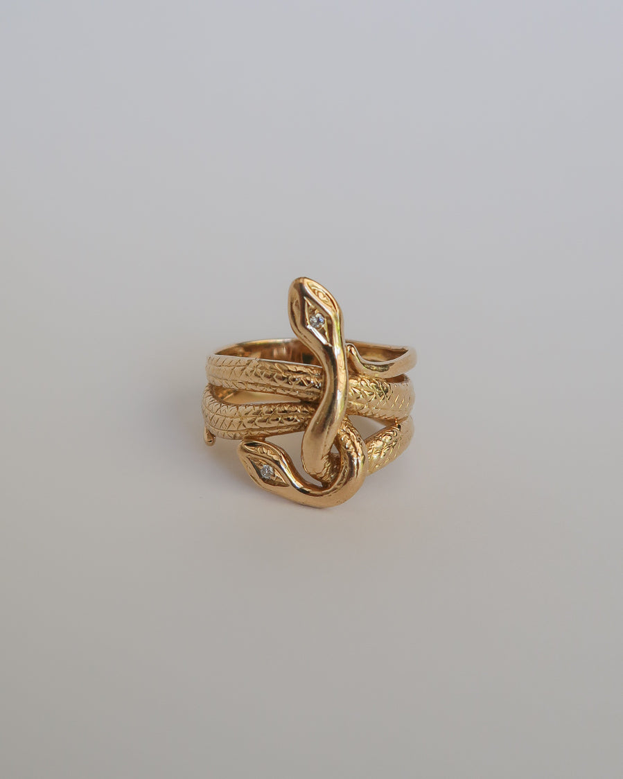14k yellow gold double snake ring with diamond eyes. for sale