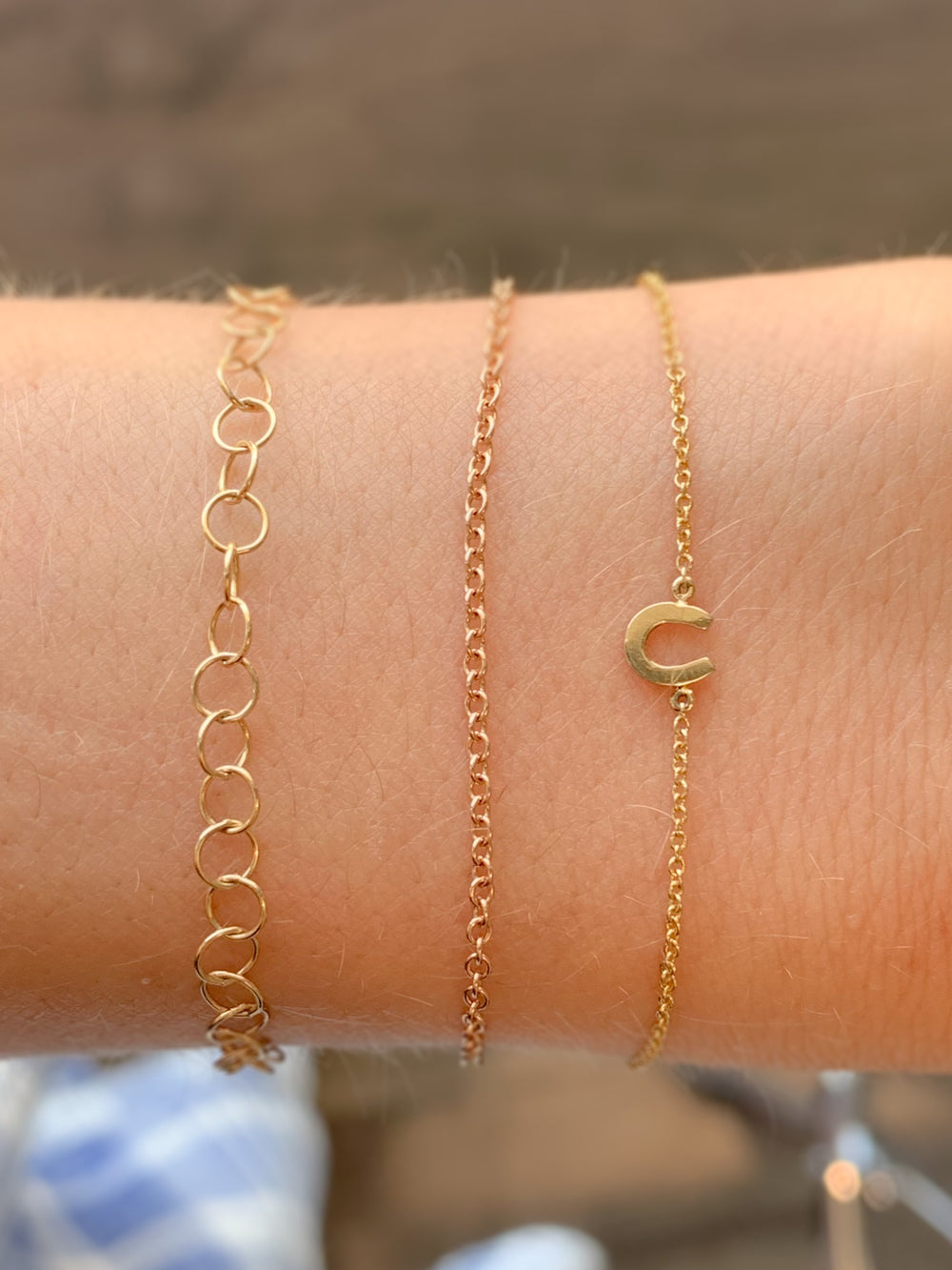 14k yellow gold bracelets with a gold horse shoe