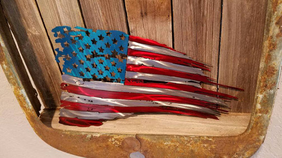 tattered and torn american flag metal art