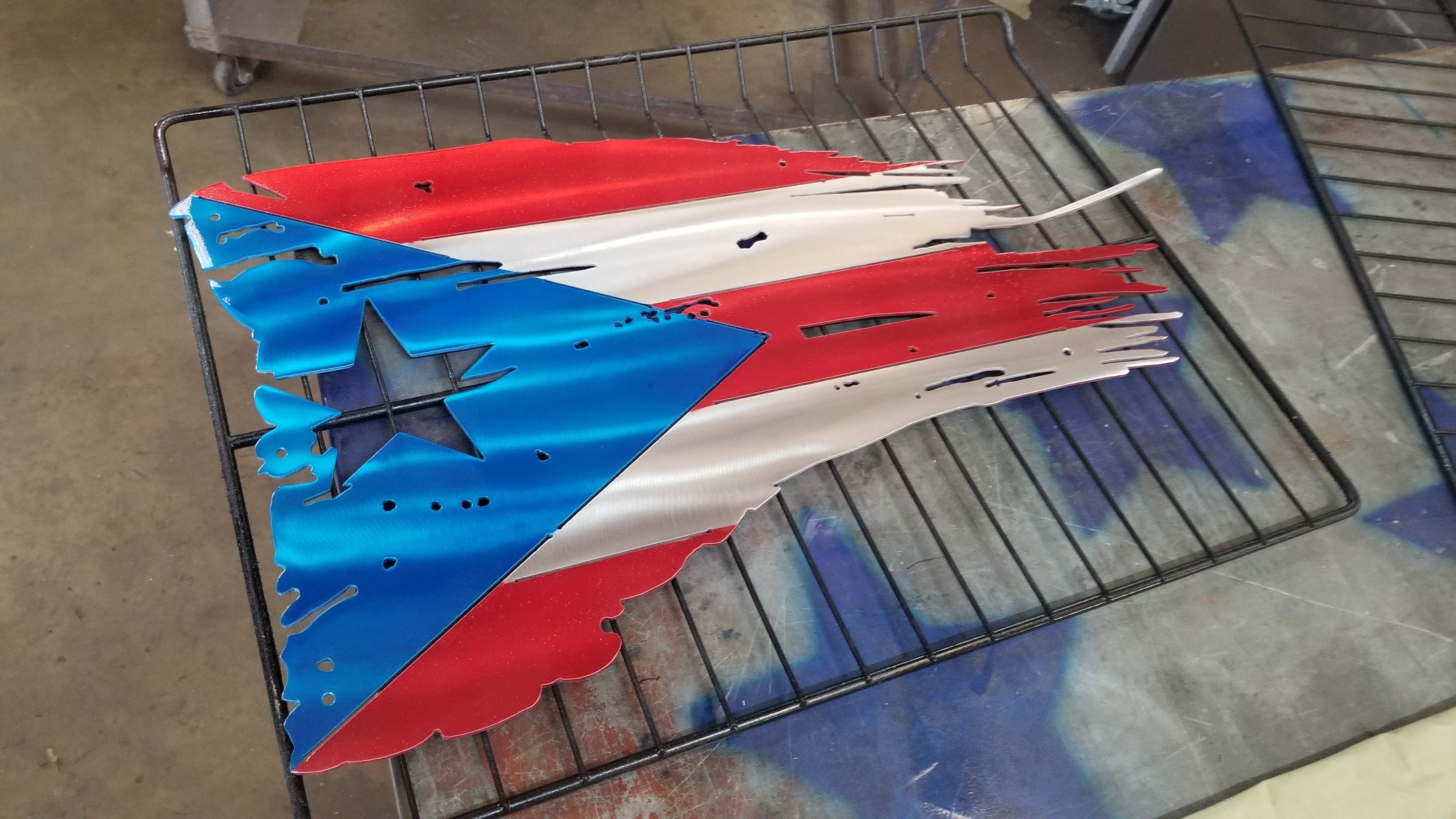 puerto rican flag tattered and torn metal art painted like the