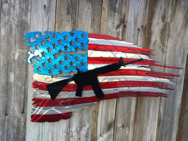 tattered american flag with ar15 rifle as second layer