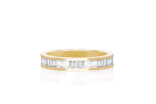 Half diamond channel set baguette diamond ring