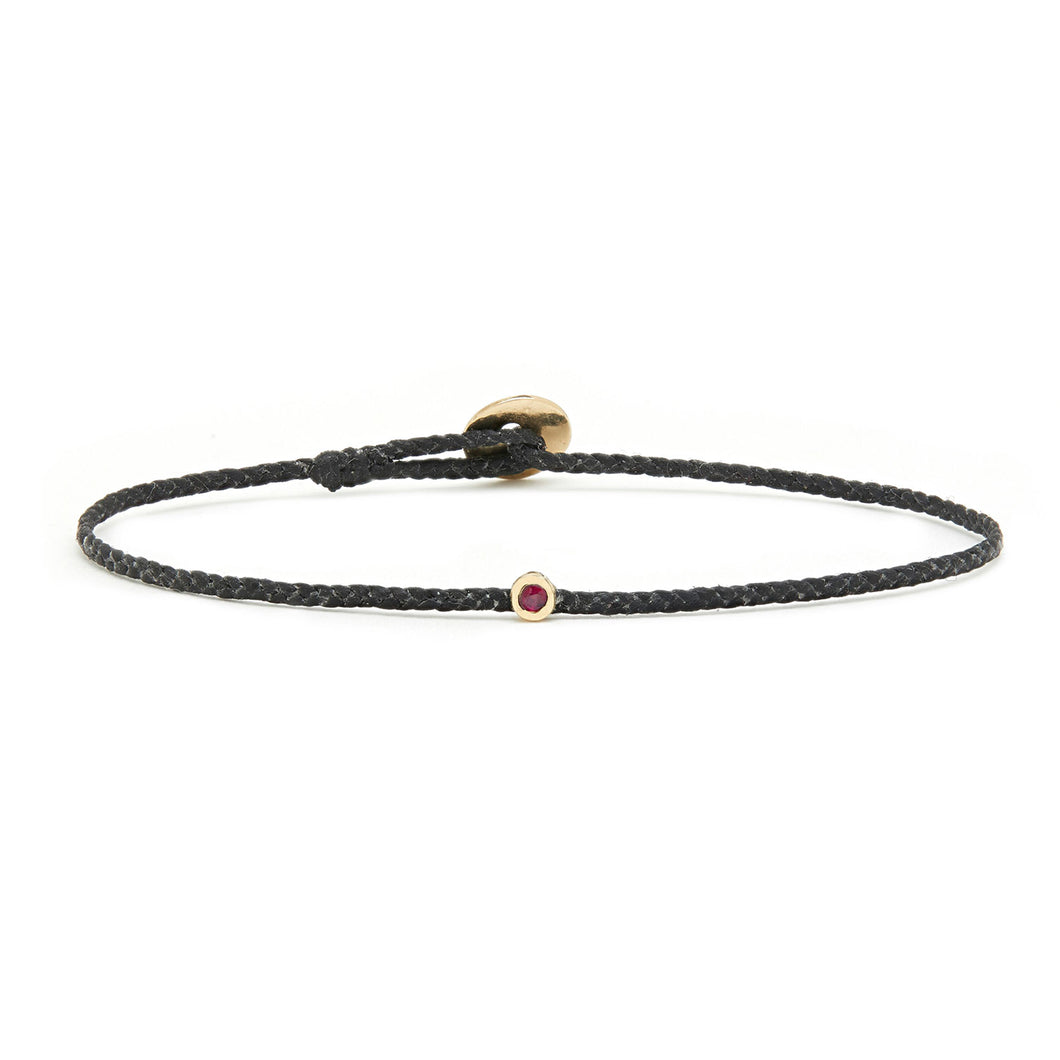 Thin black woven bracelet with Ruby