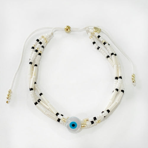 Triple strand with evil eye