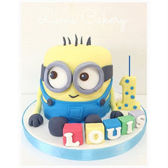 Minion cake by lims cakery