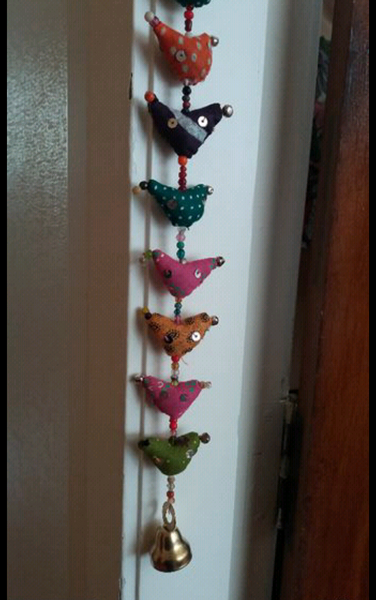 Bohemian style handcrafted fabric small birds and beads wall hanging