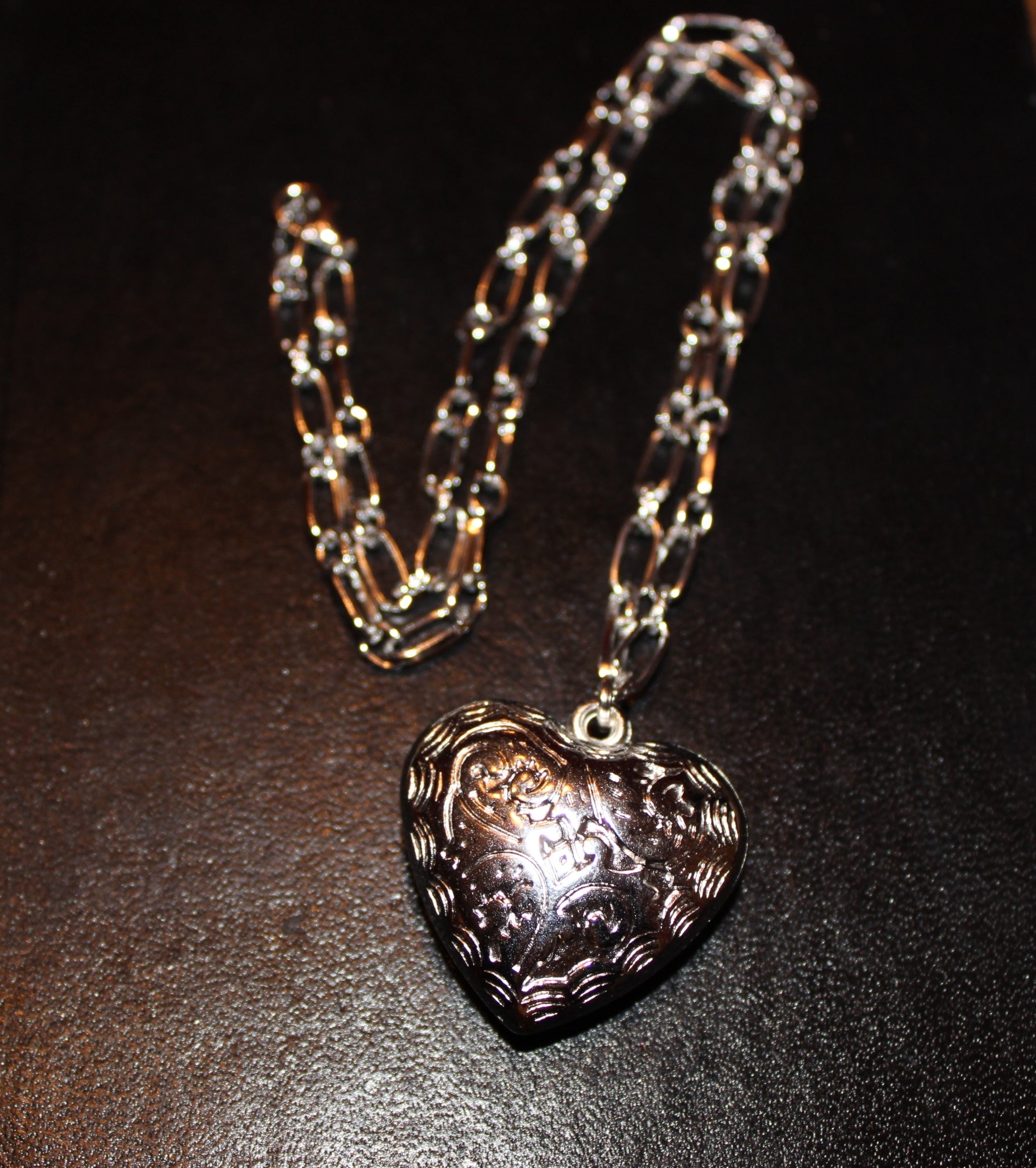 Silver heart charm designed exclusively for Little Switzerland