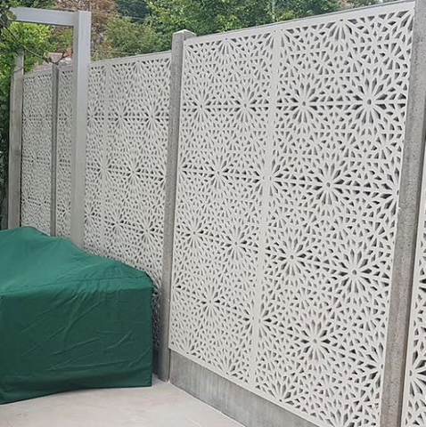 Cream garden screens installed to screen a fence with concrete posts