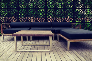 Black Kaleidoscope geometric screens by Screen With Envy installed around an outside seating area