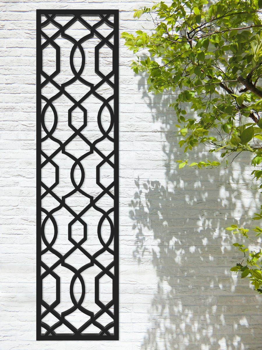 Black geometric designer trellis by Screen With Envy on a garden wall