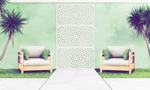 Three cream Kaleidoscope designer screens by Screen With Envy installed in an outside seating area