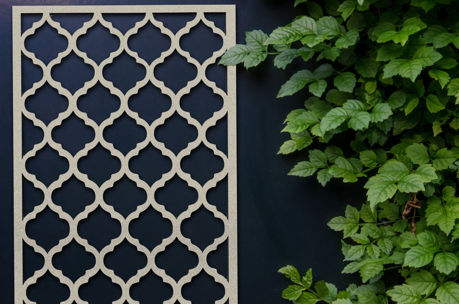 Cream Moroccan inspired garden screen by Screen With Envy on an outside wall