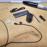 SERE Lanyard: Escape Implements and EDC Tools secured around a kevlar friction saw necklace.