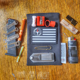 Survival Kit Lighter - Fire Starter outfitted with supplies.