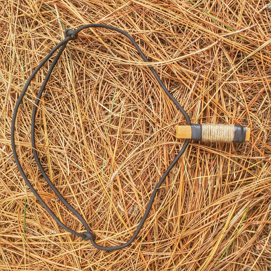 Survival Craft Collar: ParaCord Necklace, wire, fishline, tinder, firestarter, waxed wood.