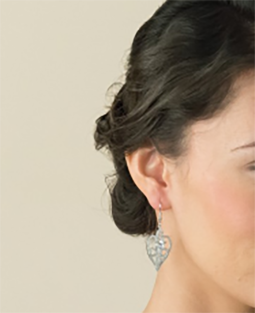 Amore crystal heart wedding earrings at lily houston design model close up image