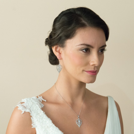 Amore crystal heart wedding earrings at lily houston design model image