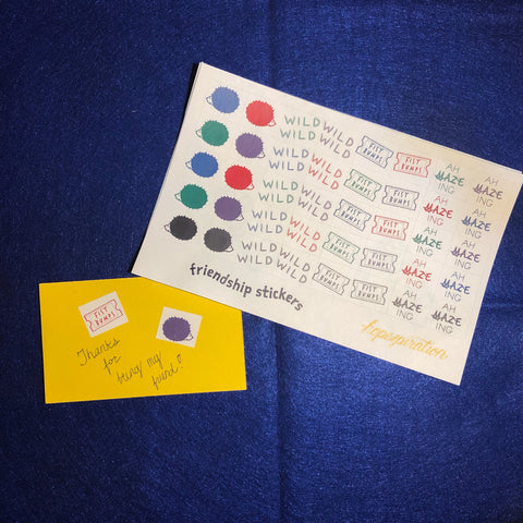 Image of sticker sheets, small yellow card with two sample stickers and text, on blue background