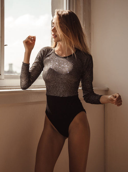 Shop this glitter bodysuit. Free shipping and easy returns