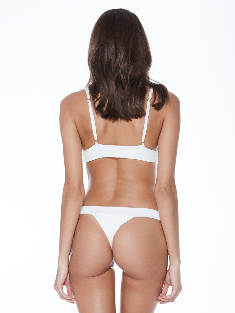 Plunging neckline bikini top in white. Thicker band for additional support. Free shipping and easy returns