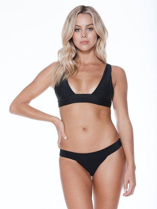 Plunging neckline bikini top in black. Thicker band for additional support. Free shipping and easy returns