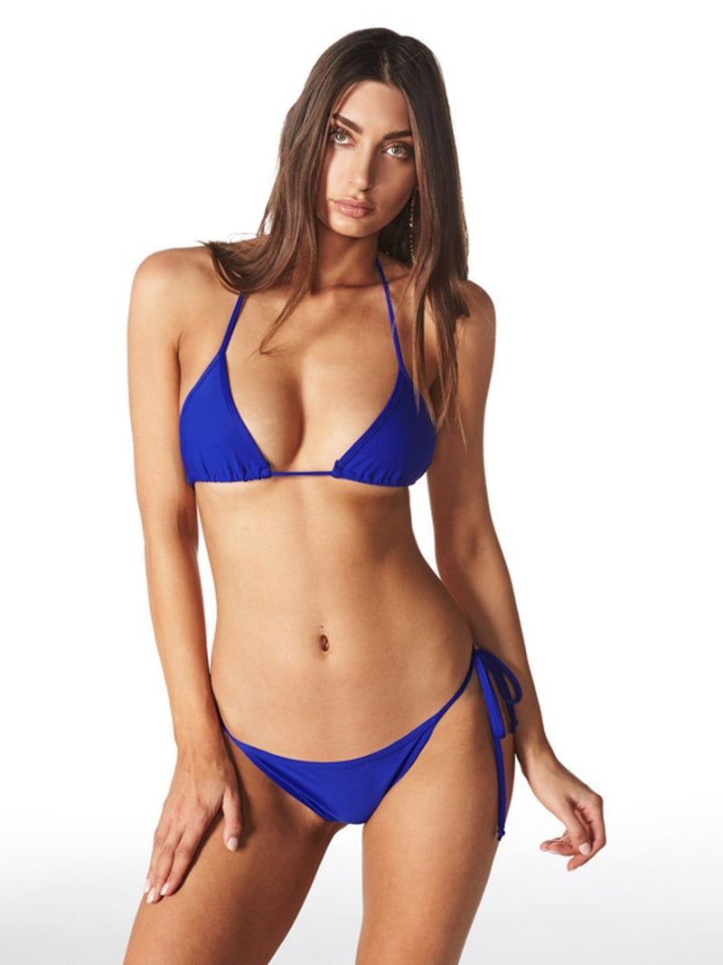 Shop the Gisele bikini set from Swm by Lioness at Crispy Citron. The bikini set features a triangle top, and a full coverage bottom with strings on the sides. We offer free shipping and easy returns when you shop with us