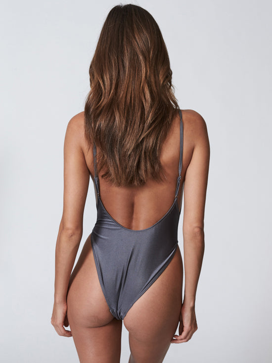Metallic one piece swimwear with a cut neckline and high cut bottom. Free shipping and easy returns