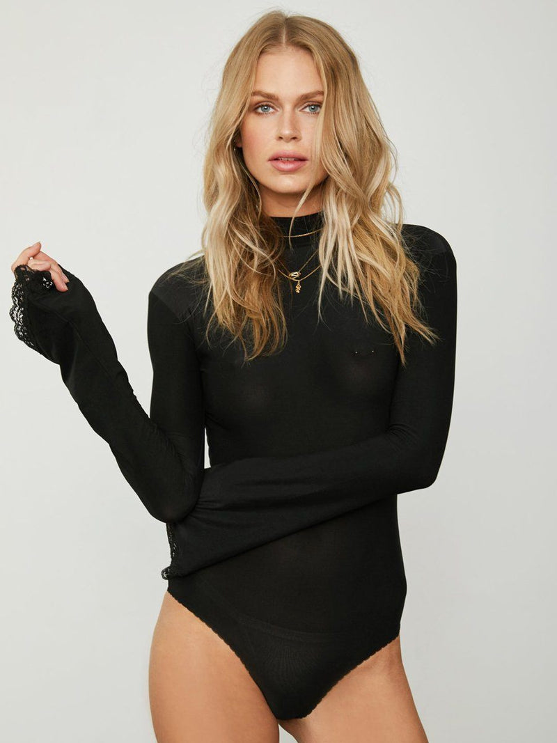 Southern bell bodysuit with a signature knit fabric. Full coverage in the front and an open back. Free shipping and easy returns