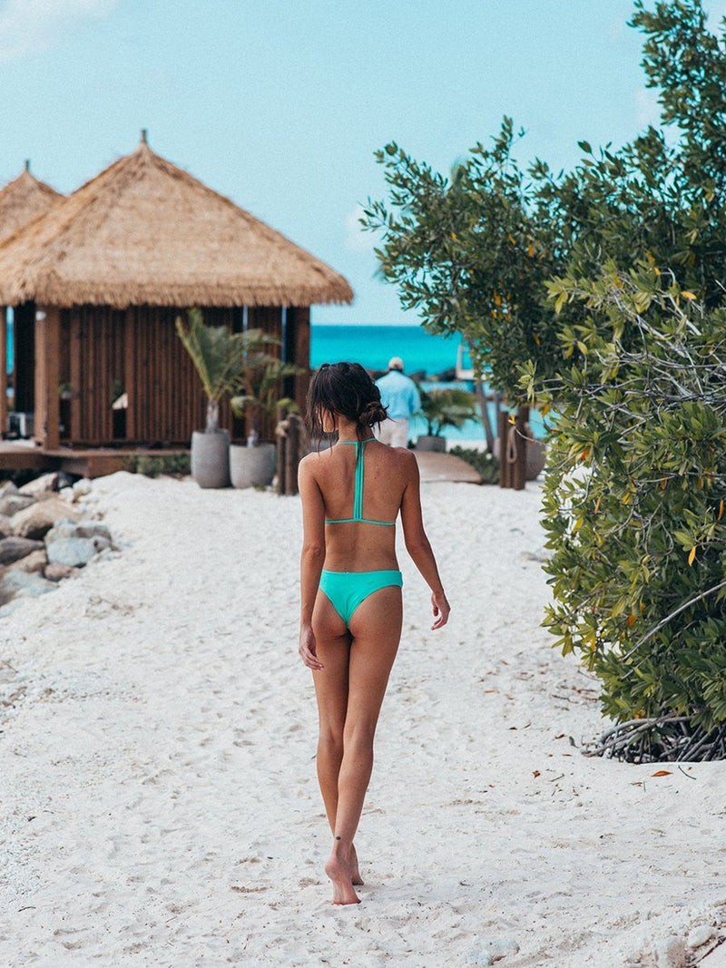 Shop the trouble in Paradise bikini by Plumeria Swimwear at Crispy Citron. Free shipping and easy returns when you shop with us