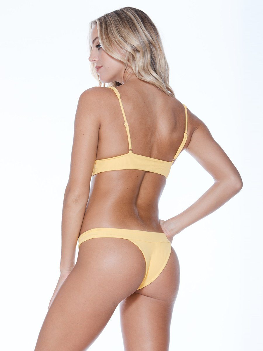 Plunging neckline bikini top in yellow. Thicker band for additional support. Free shipping and easy returns