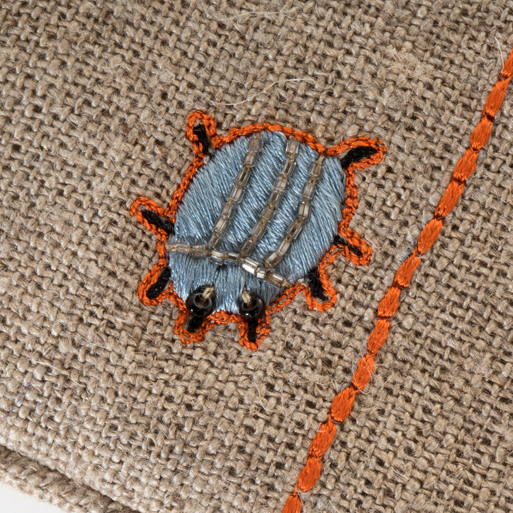 Embroidered beetle pouch
