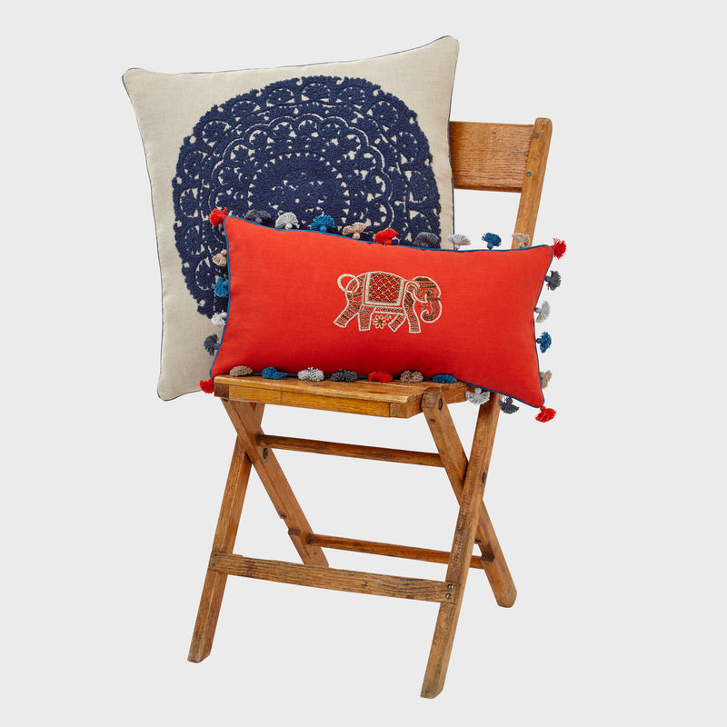 Elephant embroidered pillow, bright orange linen