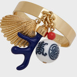 Coral and shell skinny napkin rings, navy, set of four