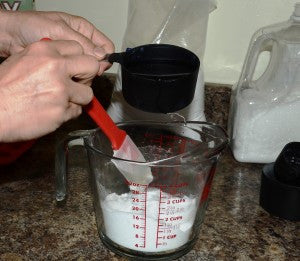 Add water a little bit at a time until mixture is moldable.