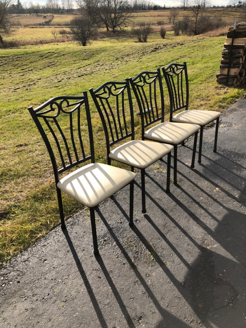 Four Black Metal Framed Padded Chairs