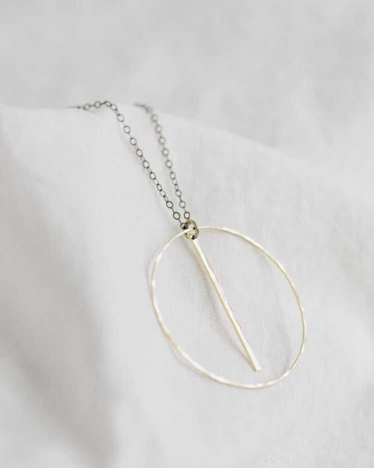 n0002 Brass Circle & Bar