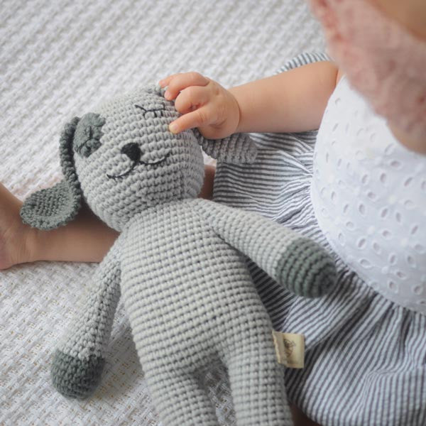 Handmade sleepy snoogu puppy dog by Cambodia Knits