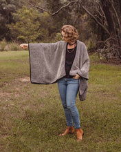 Manina Poncho in black and twill
