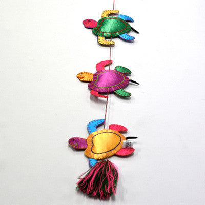 Ethically handmade turtle mobile. A beautiful gift for any decor.