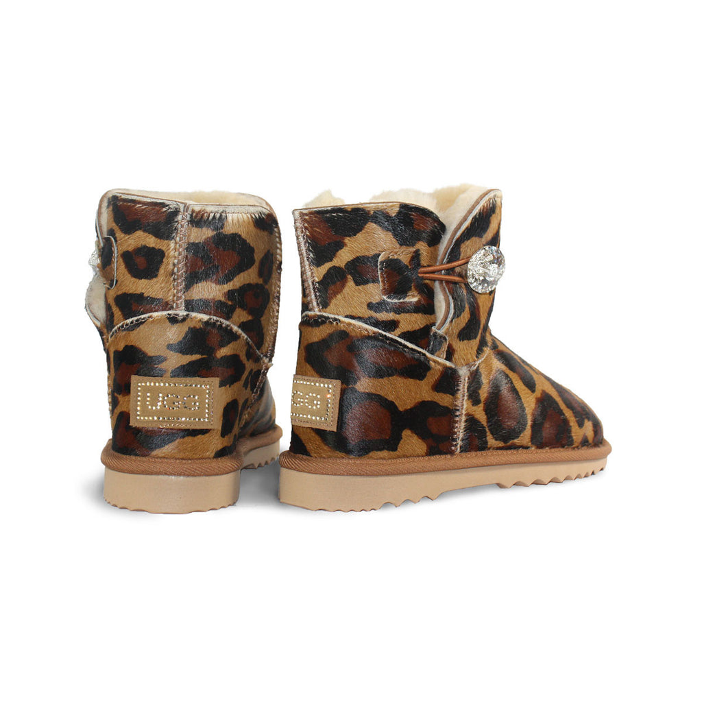 Leopard Luxe Mini sheepskin ugg boot made with calfskin with leopard print and Swarovski crystal buttons and logo online sale by UGG Australian Made Since 1974 Back angle view pair