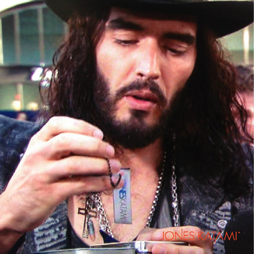 Russell Brand receiving his Jones Katami Gift on the red carpet.