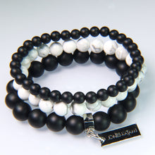 Onyx, White Howlite and Onyx.
