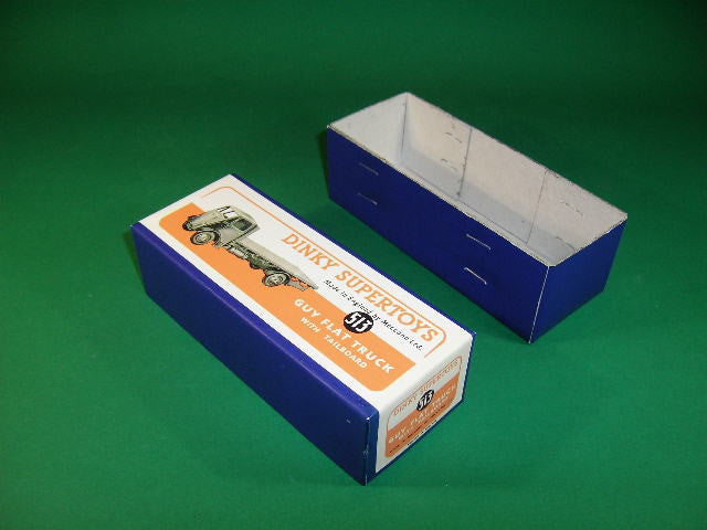 Dinky Toys #513 Guy Flat Truck with Tailboard - blue wrap.