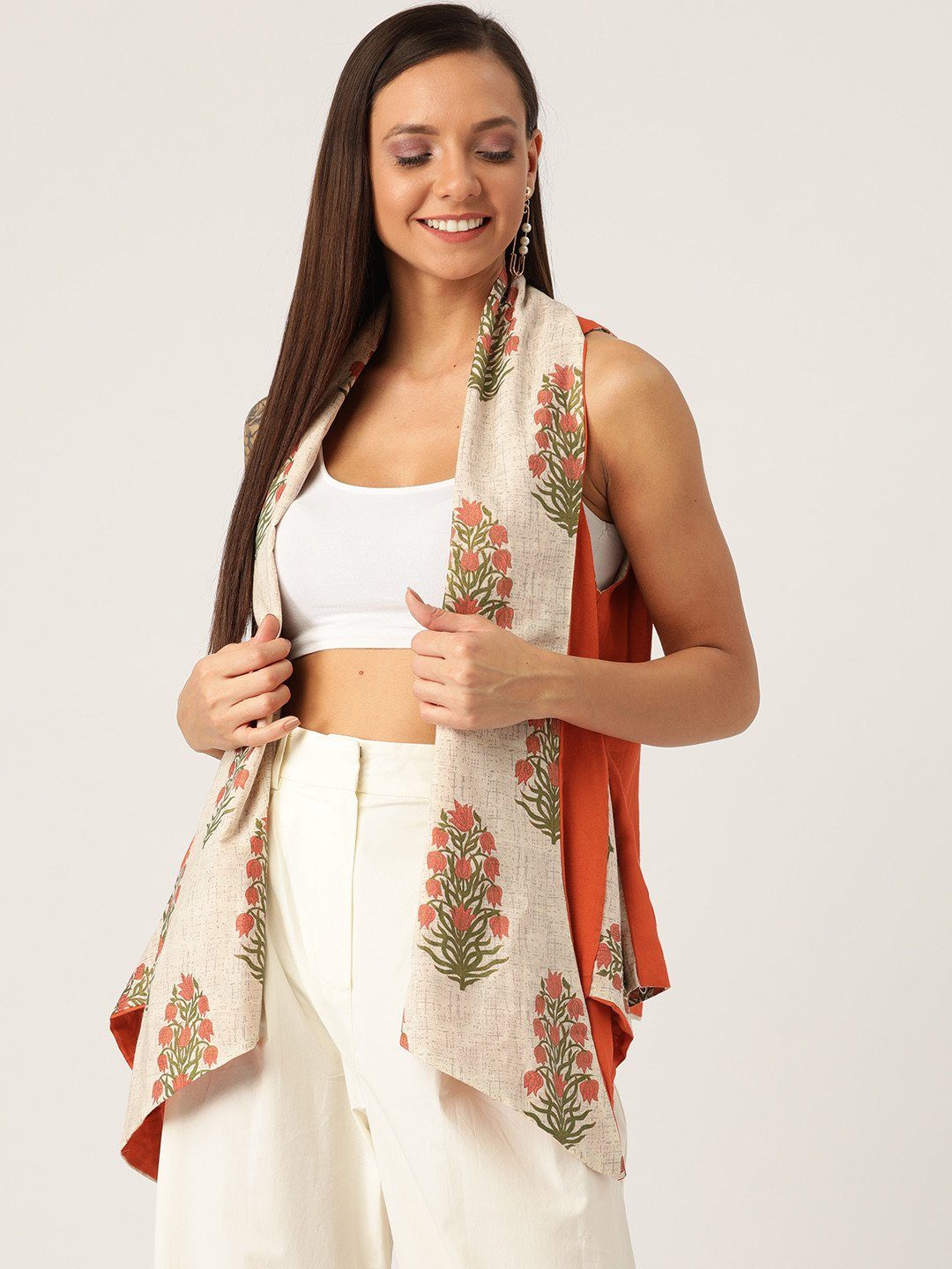 REVERSIBLE SHRUG IN OFF ORANGE FLORAL