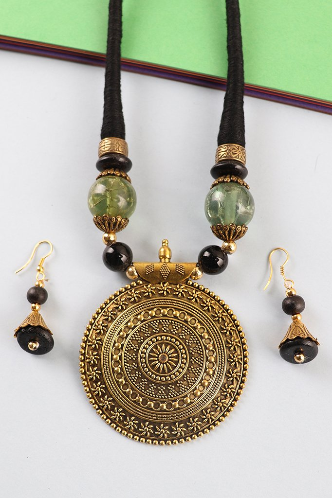 Golden Carved Statement Pendant Set in Black