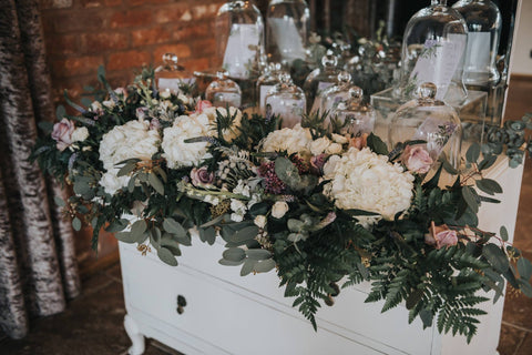 Dresser table plan with glass domes and florals